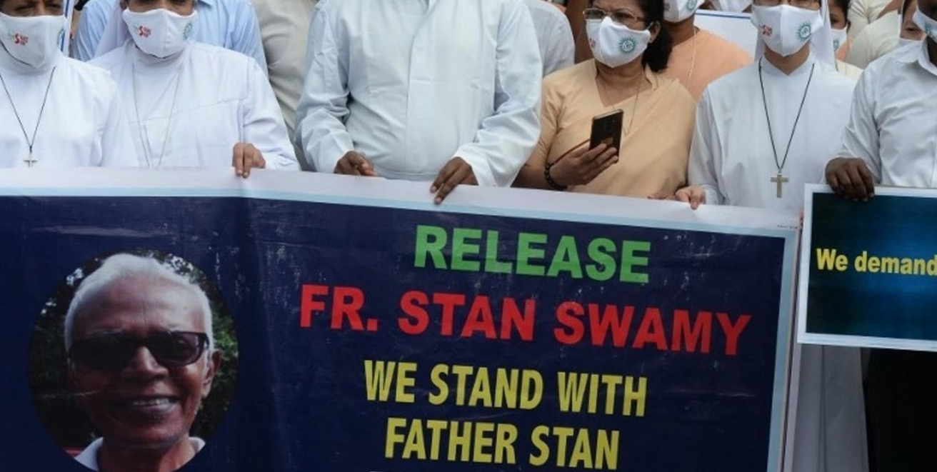 Catholic priests and nuns display a banner during an October 2020 protest of the arrest of Jesuit priest Stan Swamy.